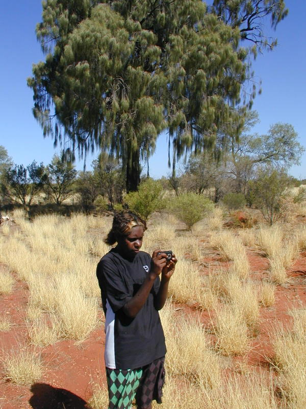 Anangu Ranger using survey equipment